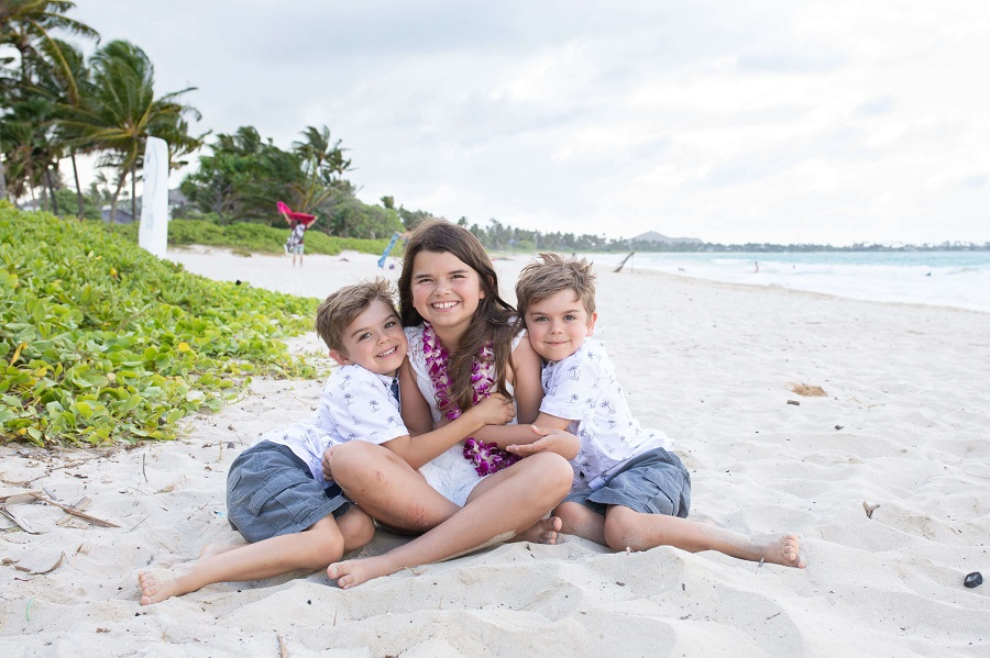 Reasons to Hire a Vacation Photographer | Child Photographer on beach on Oahu