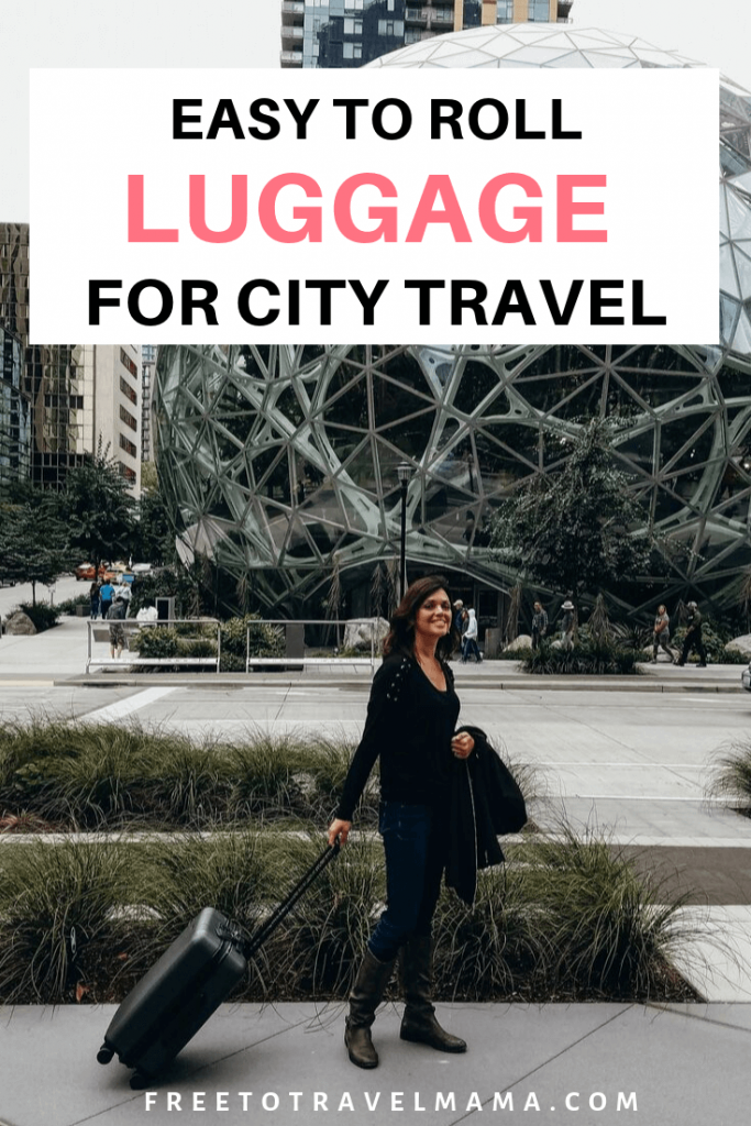 Chester Luggage Suitcases in action in Seattle | #sponsored Seattle has some gorgeous new building downtown, but this means that they are in a state of construction. So we went over some uneven sidewalks, around some construction sign detours, and even were rained on. It was a piece of cake to roll these suitcases! #freetotravelmama #bestcarryon #chesterluggage
